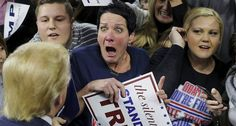 Audience member Robin Roy (C) reacts as U.S. Republican presidential candidate Donald Trump greets her at a campaign rally in Lowell, Massachusetts January 4, 2016. (BRIAN SNYDER / Reuters)
