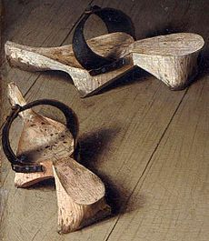 Pattens, protective overshoes, from the Arnolfini Portrait of 1434; these pattens have been put off inside the house.
