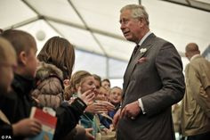 The Prince of Wales greets school children as he and the Duchess of Cornwall arrive at the Hay Festival, Hay-on-Wye 23rd May 2013