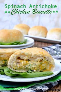 Spinach Artichoke Chicken Biscuits - spinach, artichoke, chicken, and 3 kinds of cheese baked inside a Pillsbury grands biscuit http://www.insidebrucrewlife.com