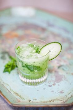 Green Machine cocktail: tequila, cucumber sweet and sour, honeydew, lime, mint, soda