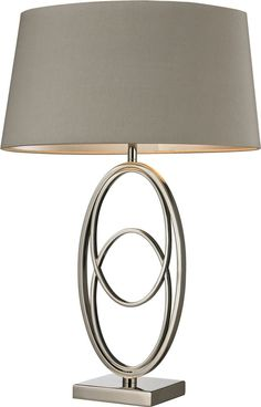 This 1-Light Table Lamp by Dimond is finished in Polished Nickel, perfect to exquisitely accentuate every aspect of your home. - Polished Nickel Finish - Features Light Grey Faux Silk / Hard Back / Si