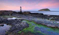 Penmon Point lighthouse and Puffin Island, Anglesey, Wales, UK. Spring (April) 2011.