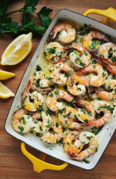 """<p style=""""margin: 0px;font-size: 12px;font-family: 'Lucida Grande'"""">This easy and delicious recipe for Baked Shrimp with Lemon and Garlic is fast, flavorful, and tastes as good as it looks!</p> <p style=""""margin: 0px;font-size: 12px;font-family: 'Lucida Grande'""""><em><strong><a href=""""http://www.yankeemagazine.com/new-england-traditions/baked-shrimp-with-lemon-and-garlic"""" target=""""_blank"""">Get the recipe here!</a></strong></em></p>"""