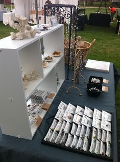 cute jewelry display using simple white shelving - shoreside chic booth #craft show display #jewelry show #show booth