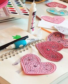 Fun doodled paper hearts for Valentine day.