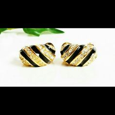 """Authentic Vintage Christian Dior Earrings Vintage Christian Dior huggie style earrings signed on clip backs, gold tone with black enamel stripes and alternating pave rhinestone stripes, each earring measures 3/4"""" x 1/2"""".  One of the earrings is missing the black enamel in the smallest back bottom section of the earring. Does not show when wearing if worn toward face. See last picture.  Price is discounted. Dior Jewelry Earrings"""
