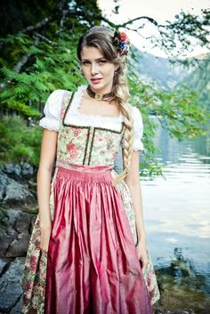 Place: Graz Textile: Fabric for dirndl Image: Lena Hoschek Dirndl SS15 Description: The fabric consitst of 100% cotton. The pattern always depicts a very playful and rural scene. For a tradtional dirndl there are always used pastel tones. These fabric represent mostly a pattern of flowers like roses or more typical ist the gentian. Additionally, the fabric is very robust and mostly combined with an apron made of silk.