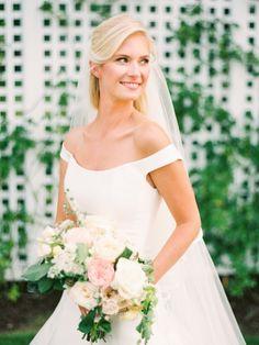 Classic + chic off-the-shoulder wedding dress: http://www.stylemepretty.com/maryland-weddings/stevensville-maryland/2015/11/20/classic-romantic-wedding-at-the-chesapeake-bay-beach-club/   Photography: Krista A Jones - http://kristaajones.com/