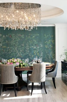 Peacock wallpaper with stunning chandelier.