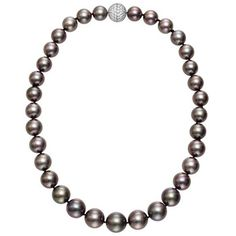 "Estate Betteridge Collection Tahitian Pearl Necklace with Pavé Diamond Clasp  Single strand Tahitian Pearl Necklace, composed of 33 Tahitian Cultured Pearls, ranging from 12-14.8mm in diameter, strung on a silk cord, with a Pavé Diamond ball clasp, set with approx.  4.98 total carats of Diamonds and mounted in Platinum. 18.5"" length. 60,000.00 USD"