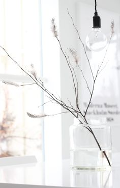 elisabeth heier - minimal branches with guinea fowl feathers - to hang easter eggs from