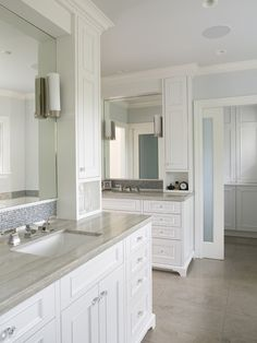 like vanity set up: counter, sink,mirror, tile, cabinets, even the lights!- Mueller Nicholls Cabinets and Construction