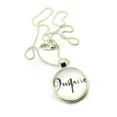 An awesome inspirational pendant galss dome necklace with the word 'Inspire', which is just what most of us need to be reminded of. Inpsire ourselves and the people around us.