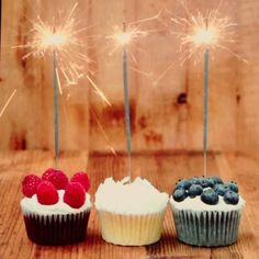 red white and blue cupcakes with sparklers
