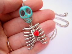 Skeleton Charm Necklace - Hangman - Skull & Rib Cage Necklace - Halloween Skull Jewelry - Turquoise and Red - Tell-Tale Heart. $22.00, via Etsy.