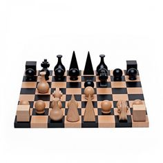 ManRay Chess Set, created 1920 Amieco Made in Germany under license of the Man Ray Trust: Made of solid Beech wood, King-an Egyptian pyramid; Queen- a medieval headdress; Bishop-a flask; Knight-the carved scroll of a violin.