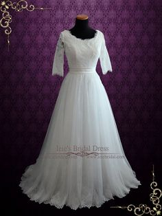 a beautiful understated elegant wedding dress fabricated with french lace soft tulle and satin