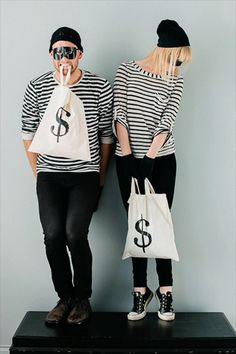 Bank Robbers! Striped shirt, a mask and a an old pillow case you can draw a $ on. Boom.