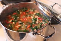 awyeaveganrecipes: TUSCAN BEAN AND KALE SOUPServes 8(Gluten free) Ingredients: 1 tablespoon olive oil 1 onion, diced 2 cloves garlic, minced 1 28oz can diced tomatoes 4-6 cups vegetable stock 1 19 oz can white kidney beans, drained and rinsed 1 large bunch kale, stems removed, chopped finely ½ lb green beans, cut into 1″ pieces ½ cup quinoa 2 bay leaves 1 teaspoon dried oregano salt and pepper Instructions: Heat olive oil in a large pot over medium heat. Add onion and garlic. Saute for 5…