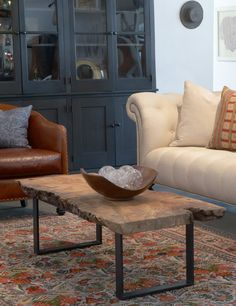 nice combination of leather, dark grey flat cabinet, weathered table and soft cream sofa