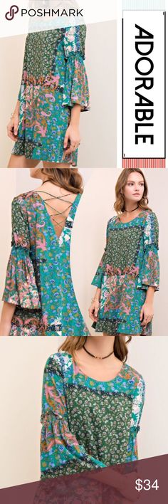7cda68915c BEAUTIFUL BELL SLEEVE DRESS Printed loose fit dress featuring bell sleeves  with smock and