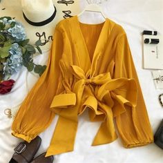 """Channeling an easygoing vibe, this long sleeve blouse will quickly become your go-to top for your smart-casual to dressy look. Dresses For Less, Ruffle Shirt, Blouses For Women, Women's Blouses, Cheap Blouses, Online Fashion Stores, Blouse Designs, Long Sleeve Tops, Bell Sleeve Top"
