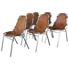 Charlotte Perriand Set of Six Chairs | From a unique collection of antique and modern chairs at https://www.1stdibs.com/furniture/seating/chairs/