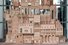 Epic cardboard castle. What have I been doing, recycling my cardboard boxes all these years? How much time have I wasted?
