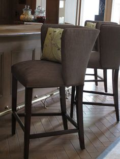Maitland-Smith barstools have been pulled up to the bar and fabulous Pearson upholstered pillows add some pizzazz.