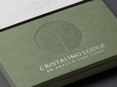 Duplex, blind embossed and silver foil business card for Cristalino Lodge designed by One Darnley Road.