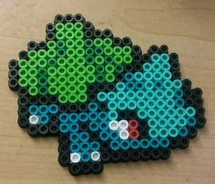 Bulbasaur sprite perler with magnets attached to the back.