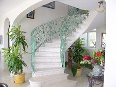 turquoise curly-cue railing, all white, curved staircase