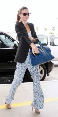 Celeb mom style steals: Copy Miranda Kerr's chic look. Find out where you can get her amazing silk ikat  print pants on a budget!