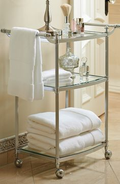 Mobilize your morning essentials with our exclusive Belmont 3-tier Rolling Bath Cart, which makes items accessible atop shelves of beveled, tempered glass.