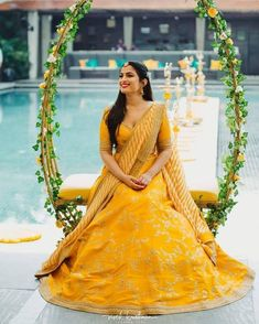 A beaming bride shining in this pretty Sabyasachi lehenga perfect for her wedding ceremony! // yellow modern and simple wedding lehenga for brides with embroidery #indianwedding #indianbride   #photography #weddingphotography #mehendi #indianceremonies #lehenga #swings #indianbride #lehengadesigns