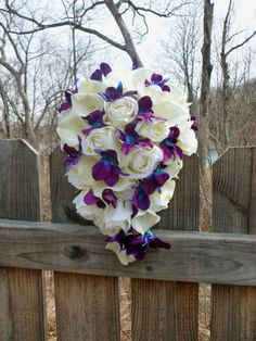 Cascading Ivory rose, calla lily and purple blue dendrobium orchid bouquet, galaxy orchid bouquet