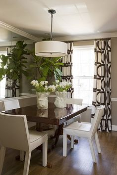 Achievable NOW. Size of the room. Curtains. Plants, and hanging light fixter and fabric chairs.