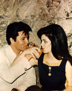 Elvis and Priscilla at their wedding party (the eve of their wedding) in Palm Springs, CA.