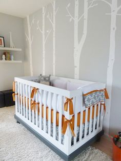 Buy a cheaper crib and paint it to match. The bottom of the crib was painted grey to match the color scheme. Genius!