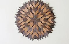 MADE TO ORDER This amazing circle wood sculpture is made from reclaimed Western red cedar. Size is a large 40 inches in diameter. Weight is 20lbs. The way the pieces have been arranged, creates tiny diamond shaped cut-outs between them. This adds depth to the wall sculpture. A real statement piece which would look great in any decor. This piece has a rustic, yet modern appearance. Stained in rich tones of pecan and dark walnut Finished with 2 coats of water based sealer Hanging hardwar...