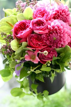Pretty deep dahlias and roses make this gorgeous floral arrangement sing a happy song.  A garden in a bouquet.