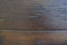 Reclaimed Dark French Oak Planks: These boards have been finished with a dark 'Tudor' hard wax oil to bring the tone down a few stops to a nice rich and luxurious dark brown almost black. These are the most precious genuine reclaimed French Oak planks available – all hand worked from ancient, reclaimed timbers. These...