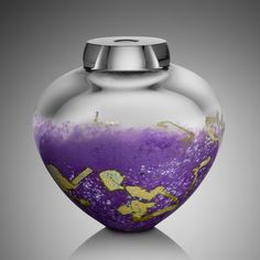 Orchid Emperor Bowl by Randi Solin. Hand blown, free-form glass off the pipe. external coloration using white powder and Japanese fine silver leaf. Each piece is truly one of a kind. The picture is illustrative of the color palette only.