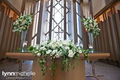 white themed wedding, beautiful white floral arrangement on church altar, Marty Leonard Chapel.