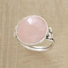 """Rose-cut faceting shows rose quartz at its finest. Handcrafted exclusive in sterling silver with a grooved, hammered band. Tapers 1/4"""" to 1/8""""W. Whole sizes 5 to 9."""