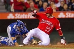 Los Angeles Angels' Chris Iannetta slides past Los Angeles Dodgers catcher A.J. Ellis to score a run during the sixth inning of a spring baseball game, Monday, April 2, 2012, in Anaheim, Calif.