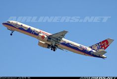 """America West Airlines Boeing 757-2S7 aircraft picture. Depicting various landmarks/symbols of the continental USA, the """"Teamwork Coast to Coast"""" livery was a lovely memory. N902AW is pictured climbing out from runway 08R, not long after America West restarted its Hawaii operations."""