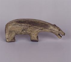 Carved animal figures could be used as toys or as amulets for protection. This polar bear is carved from ivory and dates from the 1800s. It was made in Alaska, USA.