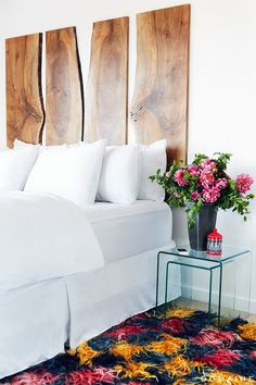 Home Tour: A Fashion Publicist's Sleek Modern Renovation. A wow headboard, great glass or plastic side table, and crazy rug. Home Bedroom, Bedroom Decor, Modern Bedroom, Master Bedroom, Beautiful Bedrooms, House Design, Interior Design, House Styles, Inspiration